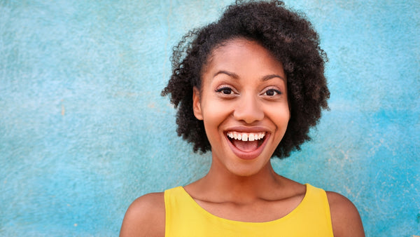 woman looking into the camera with a big smile