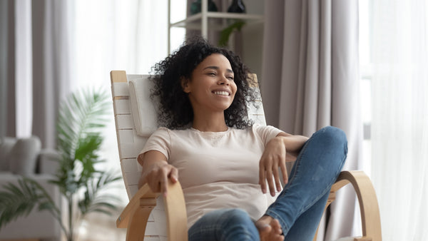 woman on a chair relaxed and smiling