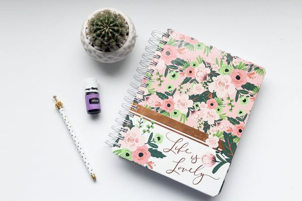 notebook with tea pencil and essential oil