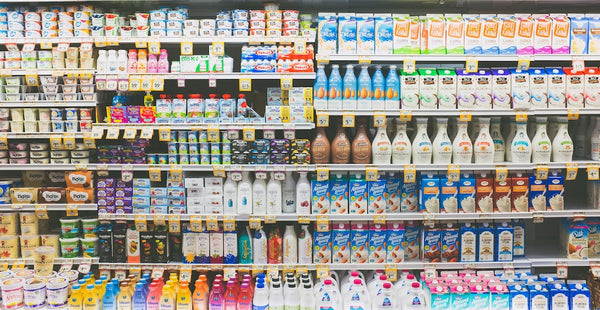 row of items in the dairy aisle grocery store