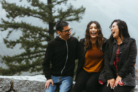 three friends laughing outside