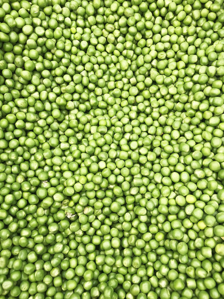 green soy beans spread out on a sheet