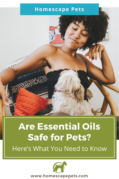 Black Woman with dog on her lap enjoying essential oils