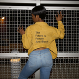 """THE FUTURE IS FEMALE AND BLACK."" Mustard Hi Lo Jacket"