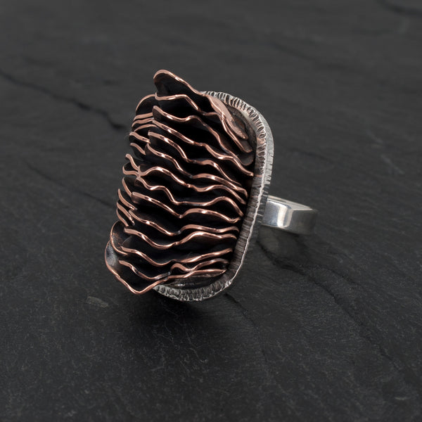 Sterling and Stacked Copper Ring side view on slate background