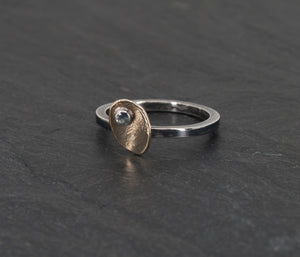 Tiny Irregular Gold Disc on a Sterling Ring with a Montana Sapphire in a Slate Background