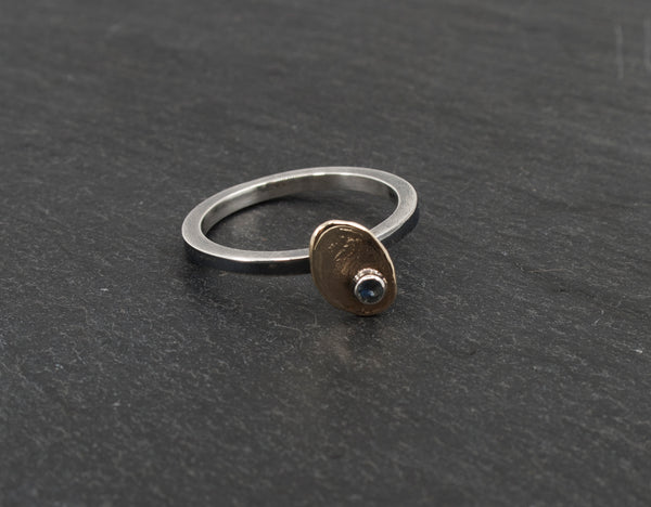 Gold Disk and Sterling Band Ring with a Montana Sapphire