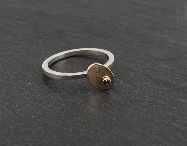 Small Irregular Gold Disc on a Sterling Band with a Created Alexandrite on a Slate Background