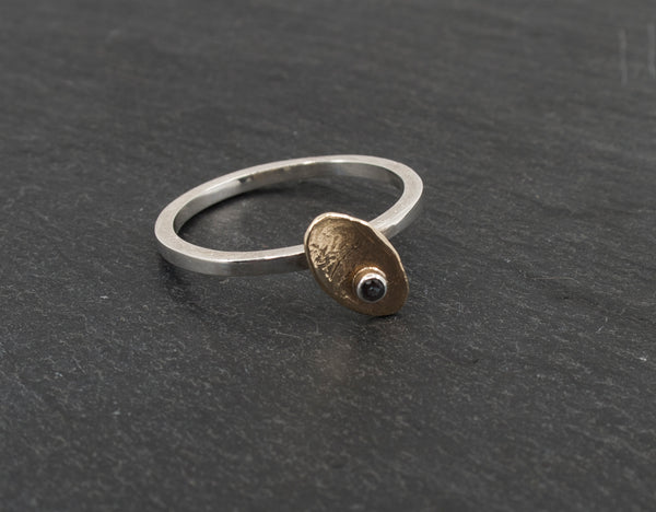 Tiny Irregular Gold Disk on a Sterling Ring with a Created Alexandrite on Slate Background