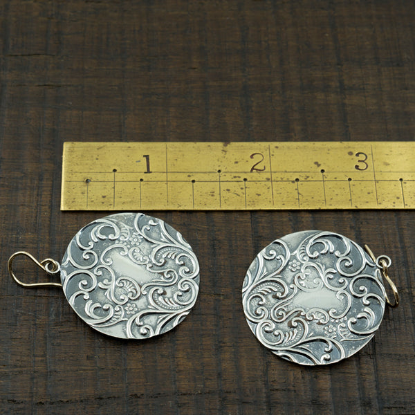 Earrings Next to a Ruler for Scale