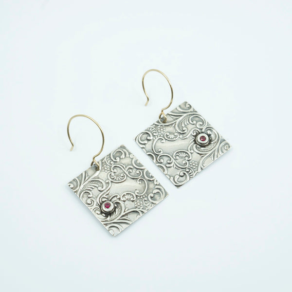 Embossed Sterling Earrings with an Abstracted Flora and Scrolling Design