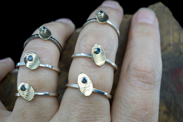 Image of Artist's Hand with 6 Similarly sized Rings for Scale