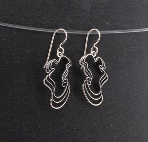 Sterling Water Waves Curvy Earrings on a Slate Background