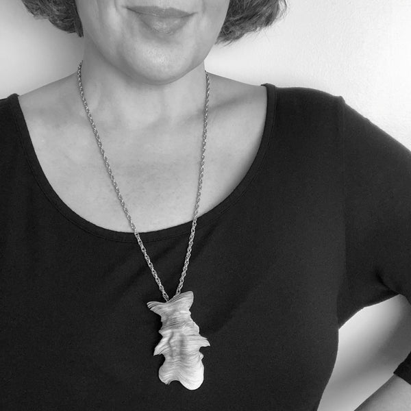 Black and  White Image of Necklace on Model for Scale