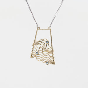 Waves/Topographic Pendant in Brass with Swiss Blue Topaz