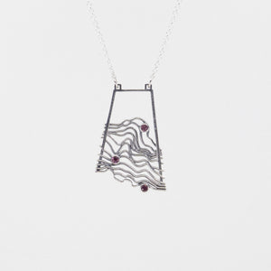 Waves/Topographic Pendant in Sterling with Rhodolite Garnets