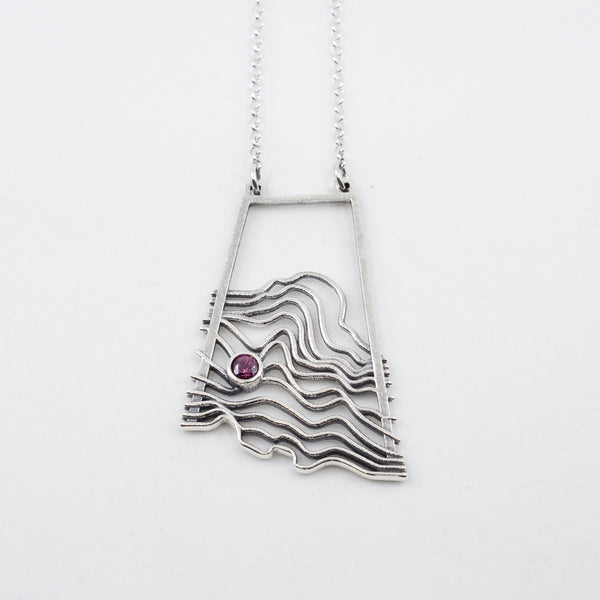 Waves/Topographic Pendant in Sterling with a Rhodolite Garnet
