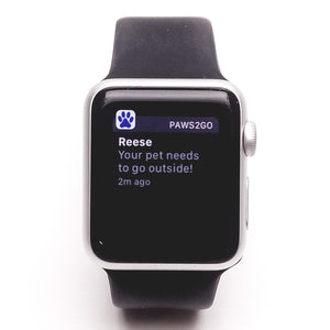 Picture of an Apple watch showing a notification after their dog touched the Paws2Go
