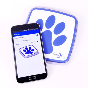 Paws2Go device with a smartphone showing the potty alert app