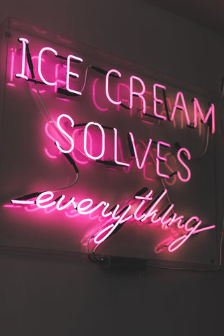 Sign saying ice cream solves everything