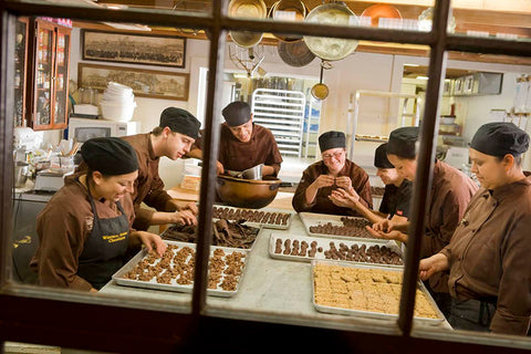 Workers at Wiseman House chocolates