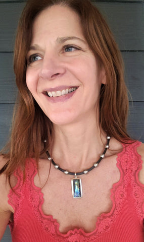 rudyblu designer wearing labradorite pendant leather choker necklace with red tank top