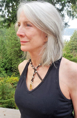 Beautiful silver haired woman wearing rudyblu leather and steel wrap necklace