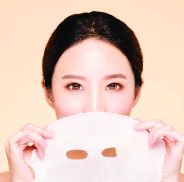 woman holding face mask