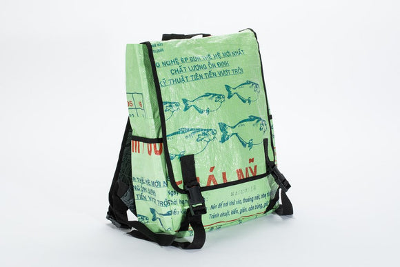 A backpack made w/ recycled materials w/ an interior divider pocket, padded shoulder straps, interior zip and slip pockets and side cargo pockets. It has a lime green background with blue fish and Cambodian printing on the front.