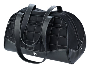 A black duffel with white stitching made with premium ballistic nylon with faux-leather detail and interior pockets for wallet, pens and phone. Soft faux-leather shoulder straps, quilted design and printed interior lining.