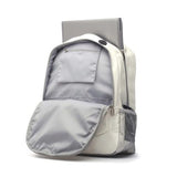 This is a white baseball backpack with red baseball stitching and black trim w/ laptop inside.