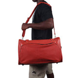 A man carrying a basketball Duffle bag made w/ real basketball material.