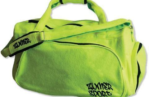 A yellow tennis Duffle bag w/ padded shoulder strap made w/ real tennis ball material.