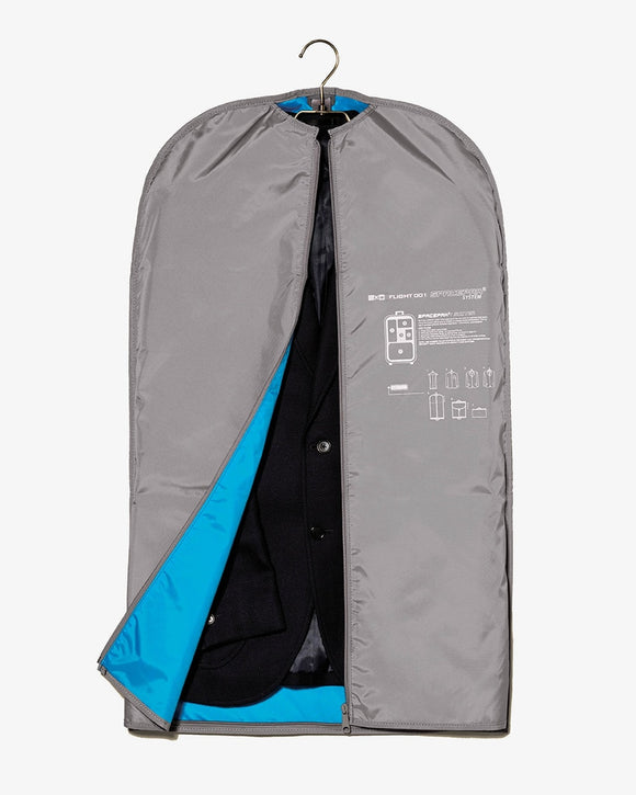 This is a grey Flight 001 travel Spacepak Suiter zippered garment bag that compresses.