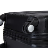 "Bottom view of black 20"" Chicago Hardside Expandable Spinner Carry-On luggage w/ double spinner wheels, top corner guards & telescopic push-button trolley handle, fully-lined interior w/ elastic tie straps & zippered garment divider."
