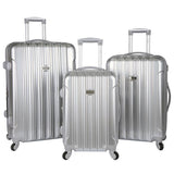A 3-pc expandable metallic silver kensie Metallic Spinner Luggage Set w/ push-button gun metal trolley handle, top & side handles, fully-lined interior w/ zippered accessory pockets, detachable PVC bag, recessed TSA lock system.
