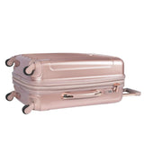 Side view of 3-pc expandable metallic rose gold kensie Metallic Spinner Luggage Set w/ push-button gun metal trolley handle, top & side handles, fully-lined interior w/ zippered accessory pockets, detachable PVC bag, recessed TSA lock system.