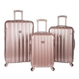 A 3-pc expandable metallic rose gold kensie Metallic Spinner Luggage Set w/ push-button gun metal trolley handle, top & side handles, fully-lined interior w/ zippered accessory pockets, detachable PVC bag, recessed TSA lock system.