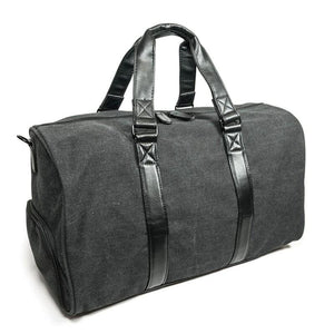 A charcoal cotton canvas duffel w/ black leather trim, inner lining & shoe compartment