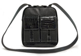 "A black women's 10"" Crossbody Tech organizer Messenger bag w/ faux crocodile accents. Has padded fur-lined pocket to store an iPad or 11"" tablet. Made of vegan leather exterior w/ contrast stitching & plaid cotton-twill lining."