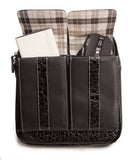 "An open black women's 10"" Crossbody Tech organizer Messenger bag w/ faux crocodile accents. Has padded fur-lined pocket to store an iPad or 11"" tablet. Made of vegan leather exterior w/ contrast stitching & plaid cotton-twill lining."