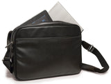 "An open black 14""-15"" Slimline Chromebook / Ultrabook Messenger bag w/ Koskin outer-shell material w/ contrast stitching & perforated accent panels. Has padded pockets for both 14.1"" Ultrabook & an iPad or other popular tablet. Space for files & accessories, interior zippered pocket, full-length exterior pocket plus organizer, adjustable shoulder strap w/ polished nickel fittings."