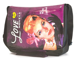 "This is a purple 15.4"" Maddie Powers Pulp Fiction Messenger bag w/ pulp magazine images from the 40s & 50s on the front, built-in cell phone pouch & plenty of interior pockets, plush velveteen trim & cushioned shoulder strap."