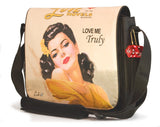 "This is a peach 14.1"" Maddie Powers Pulp Fiction Laptop Bag w/ pulp magazine images doubles as a tote bag w/ removable laptop sleeve, soft velveteen trim & old Hollywood style."