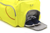 Athletic shoes inside a yellow Softball Sport Duffel Bag w/ padded shoulder strap made of actual softball leather w/ red softball stitching.
