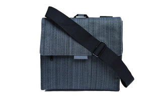 A grey in-flight travel organizer TAB messenger V2 bag w/ black shoulder strap.