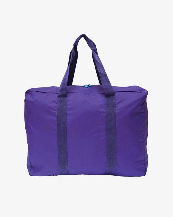 This is a Flight001 purple expandable travel tote that goes from pocket size to full size.