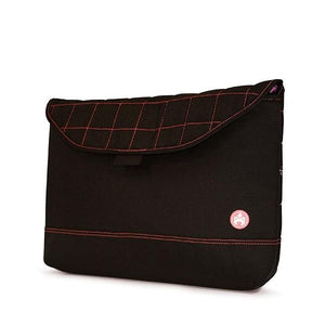"A black quilted 13"" laptop sleeve w/ pink stitching, padded corduroy computer compartment, velcro closure & sumo printed liner"
