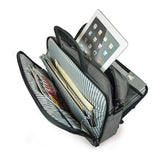 "A 16"" Graphite Corporate Briefcase w/ three exterior padded pockets, padded handles & shoulder strap showing tech gear, files & tablet inside pockets"