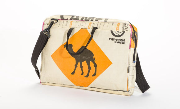 A messenger bag made from recycled material w/ foam padded separate compartment for laptop, black padded, adjustable shoulder strap, black camel on orange diamond w/ cream background.